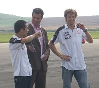 Takuma Sato and Jenson Button in Swindon 2004